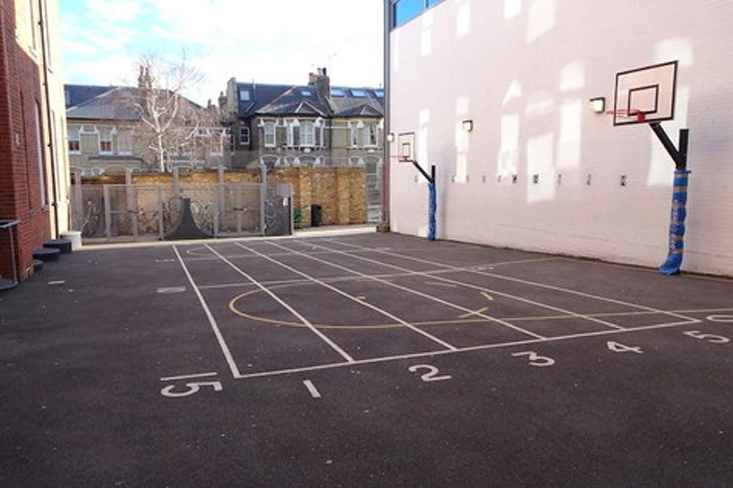 Ark Bolingbroke Academy Half court   Concrete basketball court